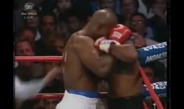 Evander Holyfield has ear bitten by Mike Tyson.