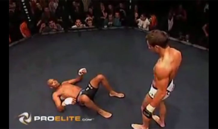 Lee Murray Stands Over Anderson Silva In The Cage.
