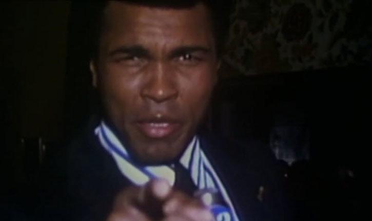 Muhammad Ali speaking to the camera.