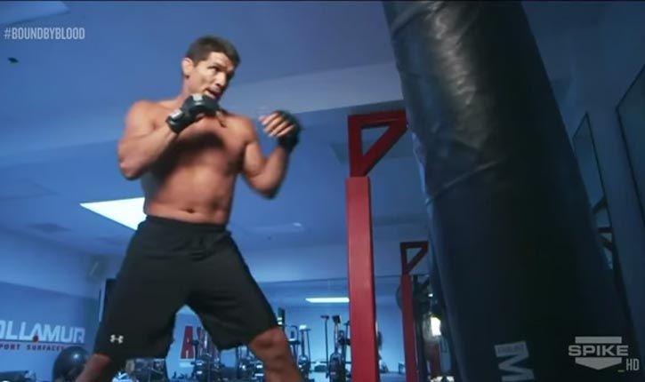 Frank Shamrock Hitting The Heavy Bag In The Gym.