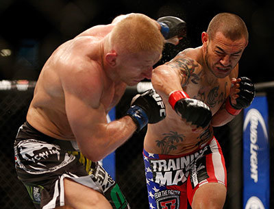 Cub Swanson lands punch against Dennis Siver in the UFC.