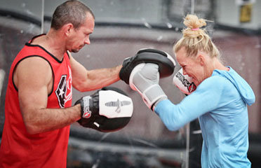 Mike Winkeljohn and Holly Holm on the pads.