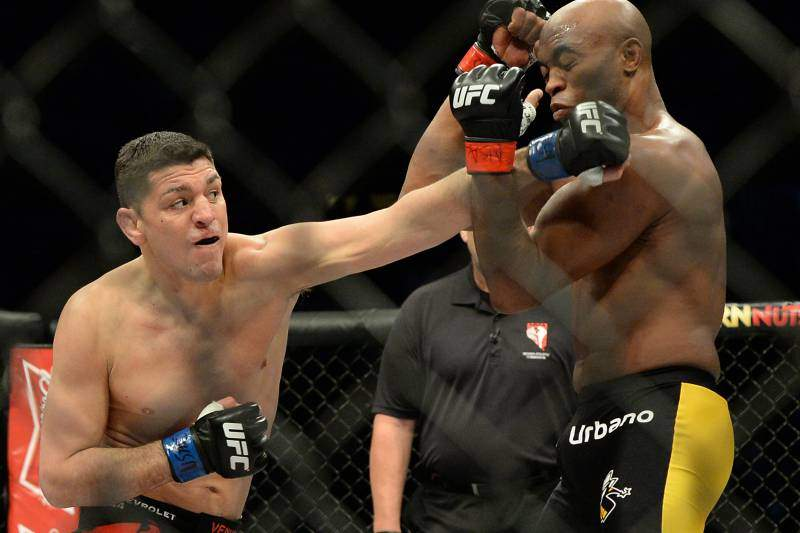Anderson Silva and Nick Diaz exchange punches.