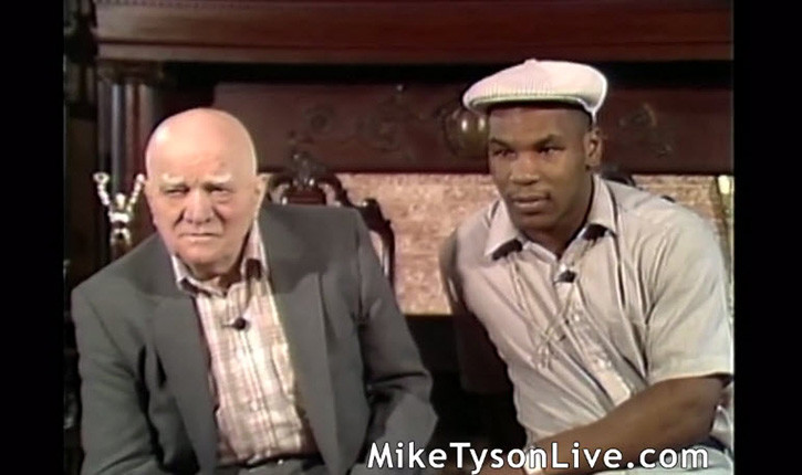 Mike Tyson and Cus D'Amato being interviewed.