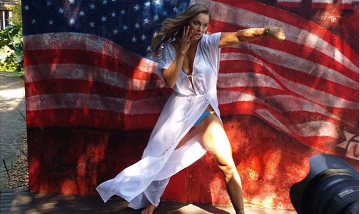 Ronda Rousey posing with US flag.