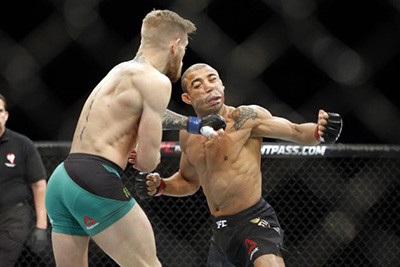 UFC 194 featherweight fight and Jose Aldo is knocked out by Conor McGregor.