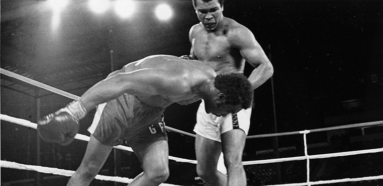 Muhammad Ali against George Foreman 1974 Rumble in the Jungle knockout photo.