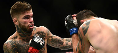 Cody garbrandt landing a left hook.