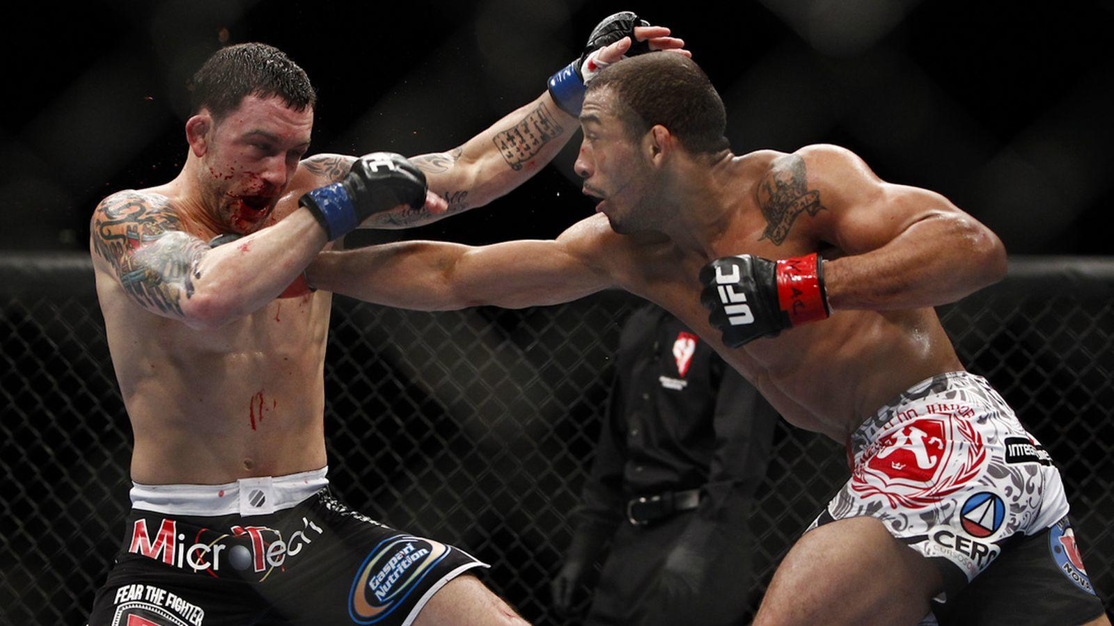 A battered Edgar takes a hard right hand from Jose Aldo.