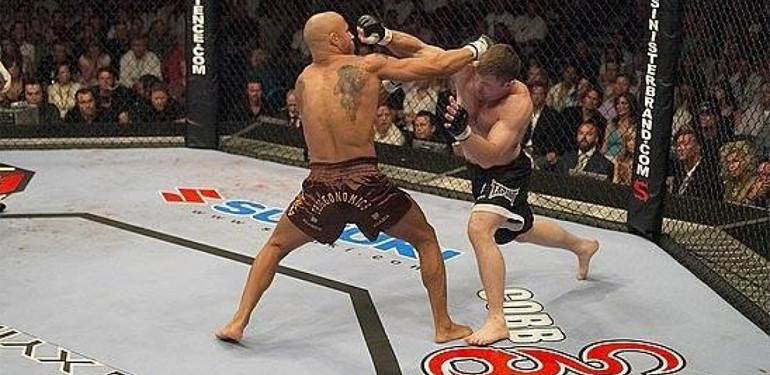 Matt Hughes and Frank Trigg exchange blows inside the UFC octagon.