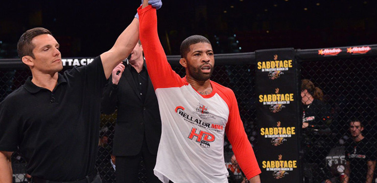 LC Davis gets his hand raised following victory inside the Bellator cage.