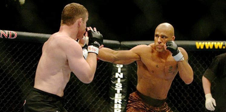 Matt Hughes and Frank Trigg in the midst of their second fight.