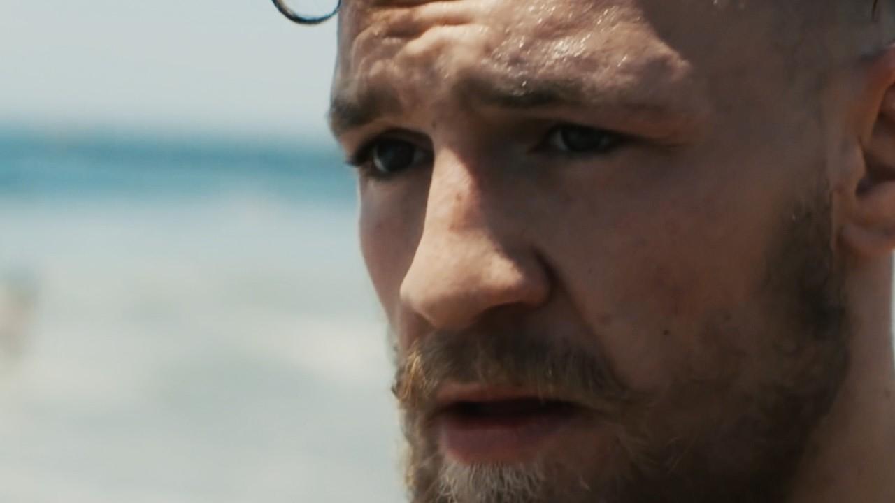 Conor McGregor profile photo of him on a beach.