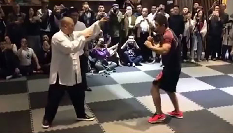 MMA fighter faces tai chi master.