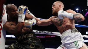 Conor lands on Floyd Mayweather.