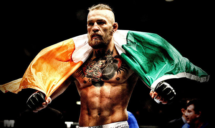 Conor McGregor with the Irish National flag draped over his shoulders.