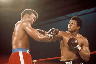 Muhammad Ali hits George foreman.