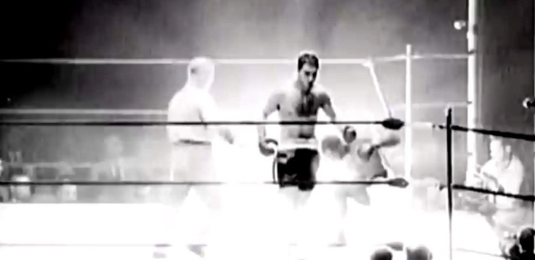 Rocky Marciano boxing in the ring photo.