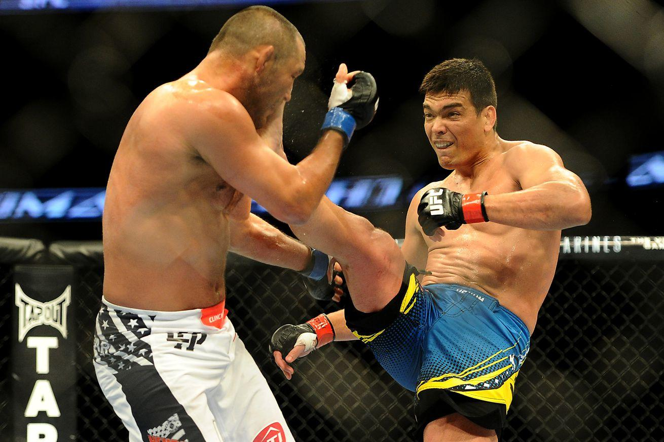 UFC japan lyoto machida kicks Dan Henderson.