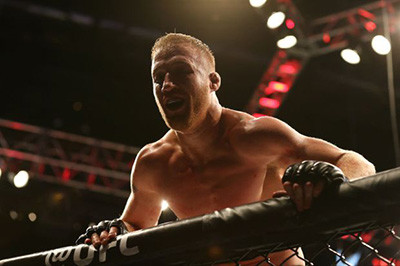 Justin Gaethje on the cage.