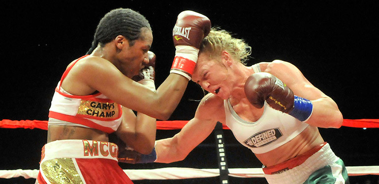 Holly Holm and Mary McGee exchange punches in final boxing match.