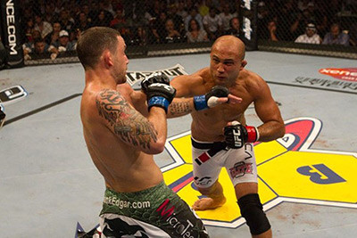 Frankie Edgar against BJ Penn in the UFC octagon.
