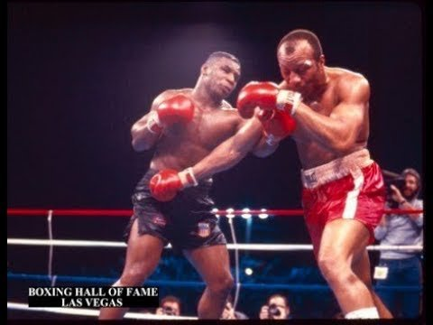Mike Tyson Defeats Bonecrusher Smith.