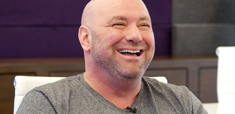 Dana white laughing while being interviewed.