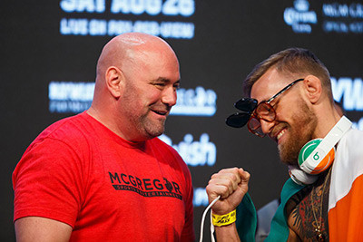 Dana white and Conor McGregor together laughing.