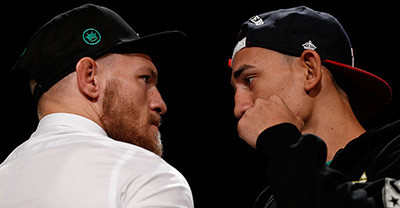 Conor McGregor vs Max Holloway faceoff.