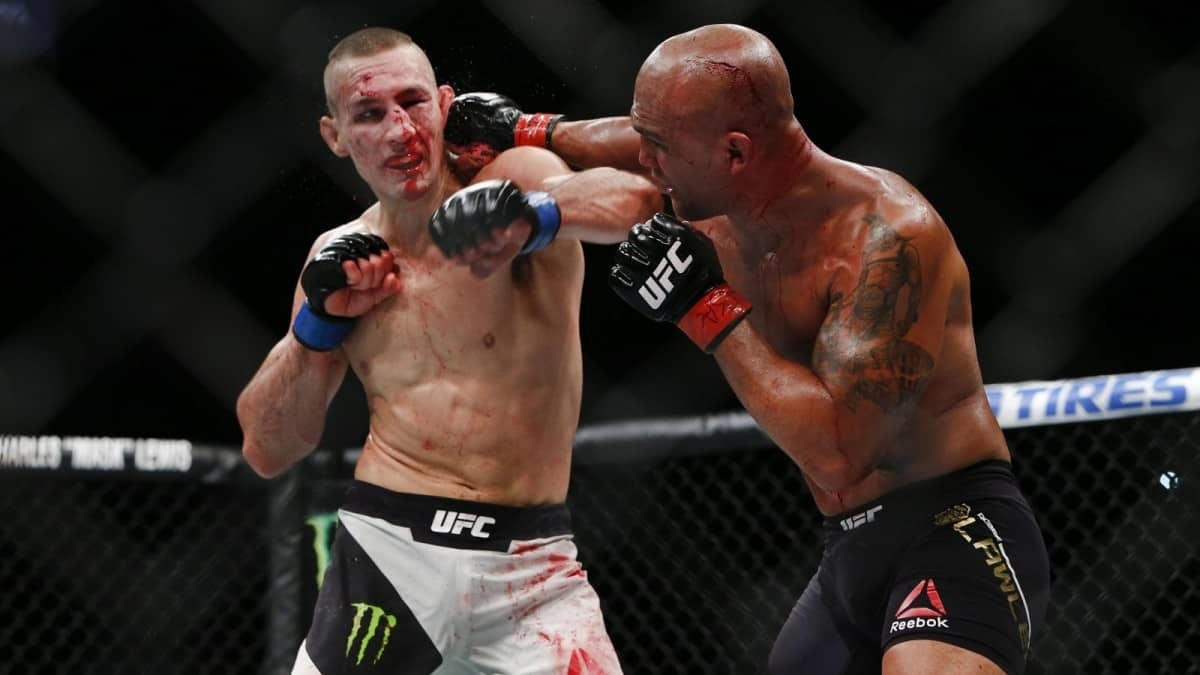 Robbie Lawler vs Rory MacDonald in the cage.