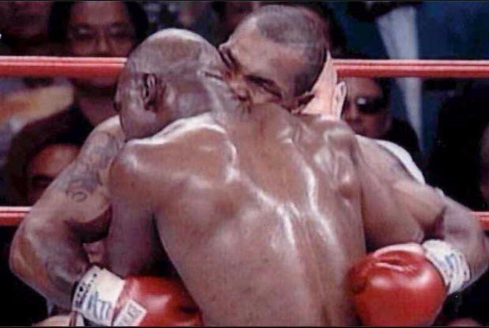 Mike tyson bites evander holyfields ear.