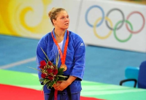 Rinda Rousey with her Gold medal from Olympics.