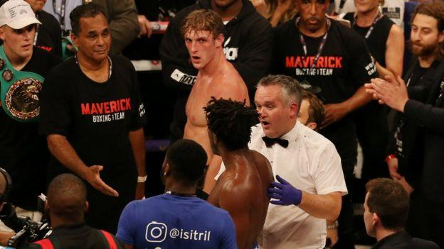 KSI and Logan Paul inside the boxing ring.