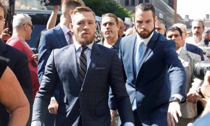 Conor McGregor in New York being led to court .