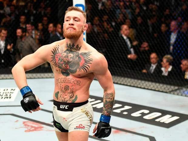 McGregor struts inside the cage