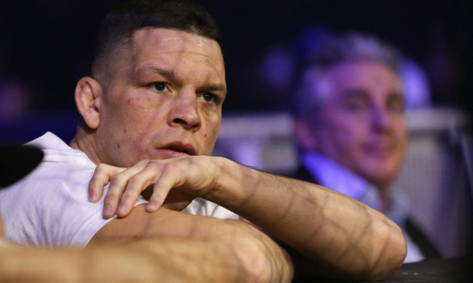 Nate Diaz sits cageside at WSOF event.