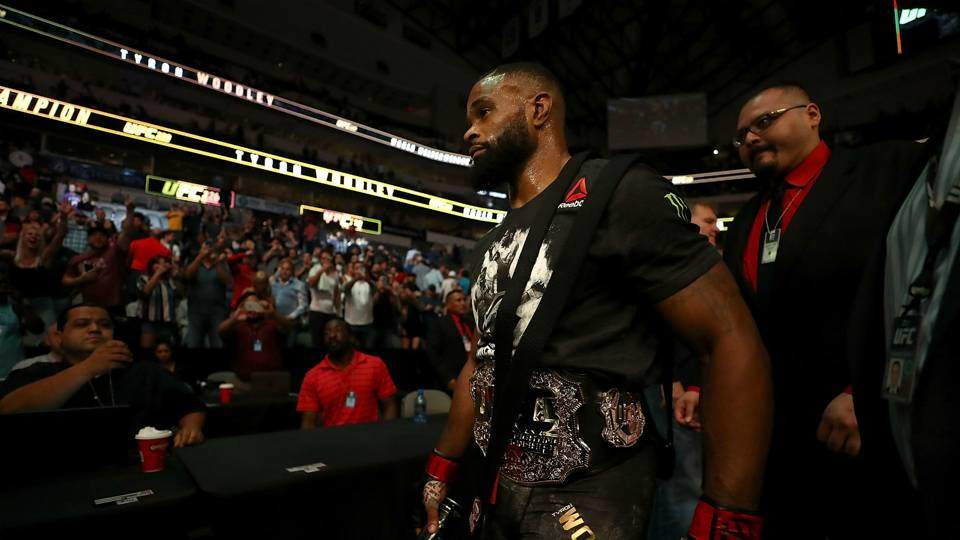 Tyron Woodley welterweight king walks in Stadium.