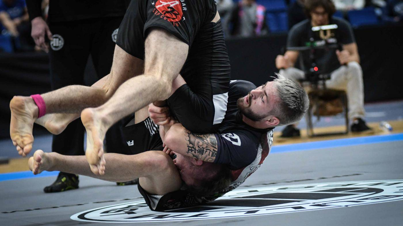 Throwing his opponent in jiu jitsu.