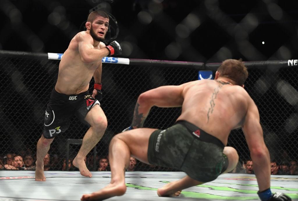 Khabib Nurmagomedov of Russia (L) chases down Conor McGregor.