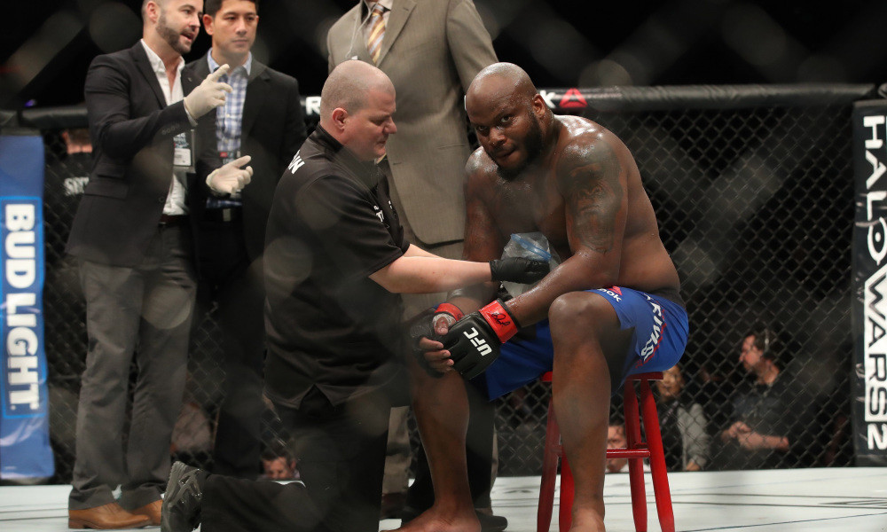 Derrick Lewis on the stool inside the UFC octagon.