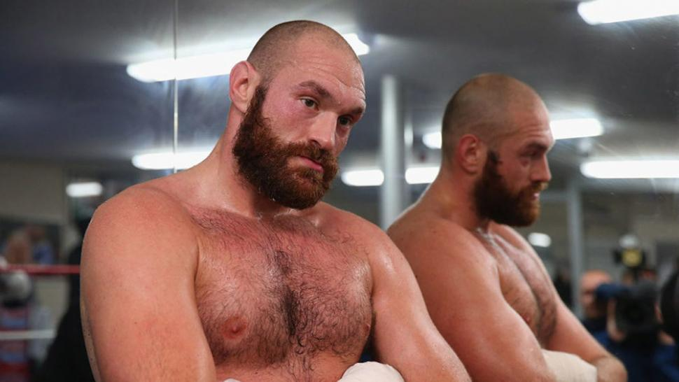 Tyson fury back in boxing poses for the camera.