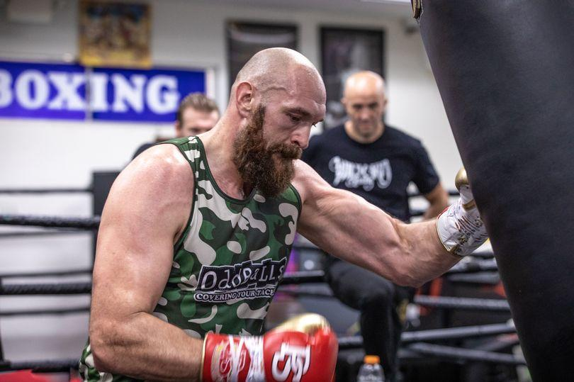 Tyson Fury hits the heavy bag.