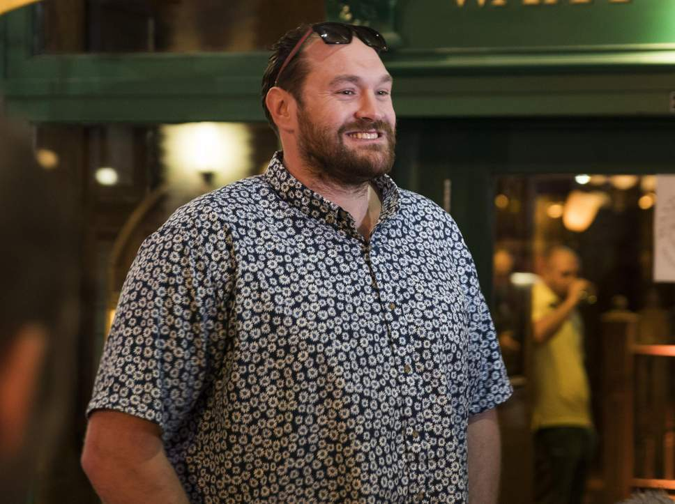 Massively overweight Tyson Fury smiling ear to ear.