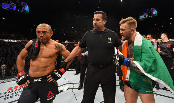 Conor McGregor with Jose Aldo.