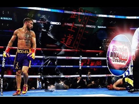 Vasyl Lomachenko stand over Adam Corolla in their fight.