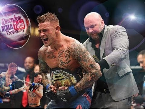 Dustin Poirier having UFC belt put on by Dana White.