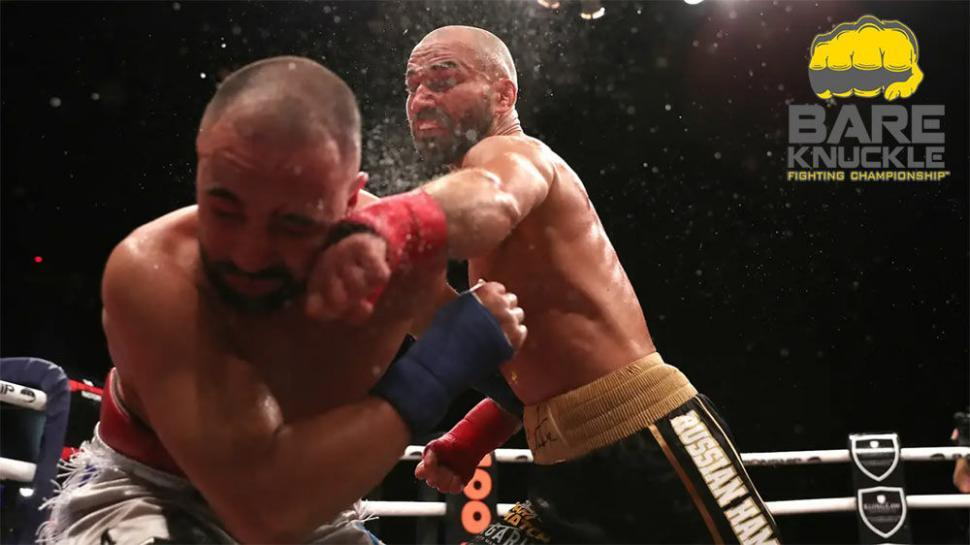 Artem Lobov landing a punch on Paulie Malignaggi.