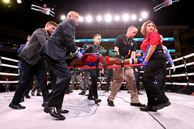Boxer Patrick Day is carried from the ring unconscious.
