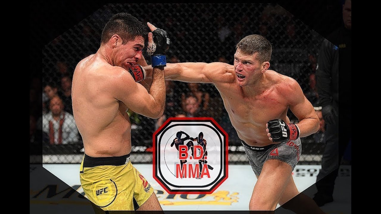 Stephen Wonderboy Thompson in the cage with Vicente Luque.